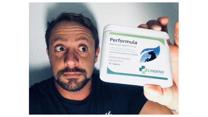 featured image of me holding my order of performula pills for a consumer review article