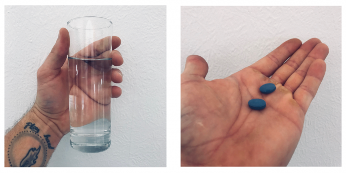 image of me holding a glass of water and 2 max performer pills